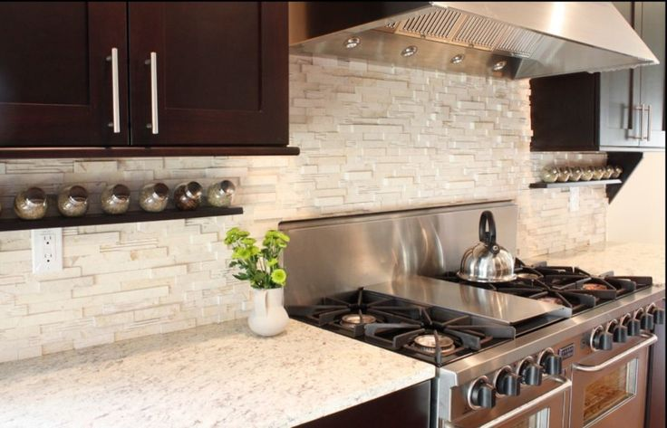 Kitchen Design - Ideas and Picture - Kitchen Worktops : Combination of Dark Cabinets with Light Countertops and Stacked Soap Stone Backsplas...