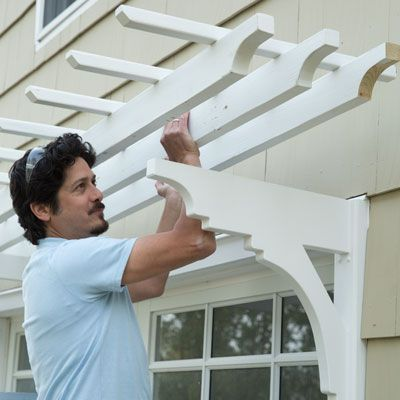 Use milled brackets and pressure-treated lumber to create an elegant canopy over your garage door. | How to Build a Garage Pergola | This Old House