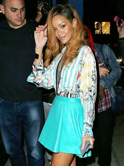 (Even though I don't care for Rhianna) This is, hands down, the best outfit I have seen in a long time! Colorful Balmain button-down and super short tiffany blue pleated leather skirt .