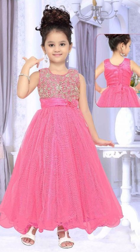 Lovely Pink Net Designer Readymade Kids Gown  DT50842  Get your child look like a princess in this Pink net readymade kids gown. Best outfit for any party functions. This dress has sizes available from 18 to 30
