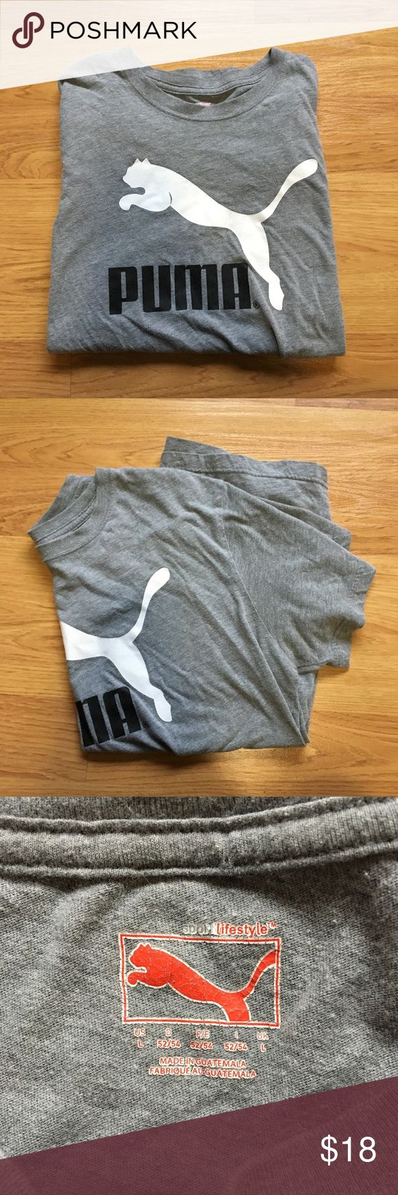 unisex GRAY PUMA T SHIRT SIZE LARGE LARGE. IN AMAZING CONDITION. BIG LOGO ON THE FRONT. SHORT SLEEVE. GRAY. Message me questions!  MAKE OFFERS! Puma Shirts Tees - Short Sleeve