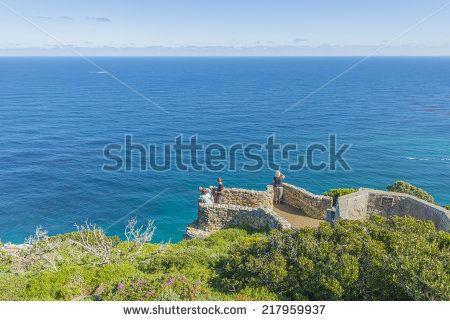 http://www.shutterstock.com/pic-217959937/stock-photo-cape-point-is-located-near-the-city-of-cape-town-south-africa-the-peninsula-has-towering-rock.html?src=l2UmwzKl67EMHu1DgRoo8g-1-13 Cape Point Is Located Near The City Of Cape Town, South Africa. The Peninsula Has Towering Rock Cliffs And Lighthouse That Overlook The Beautiful Ocean View. A Tourism And Travel Hot Spot. Stock Photo 217959937 : Shutterstock