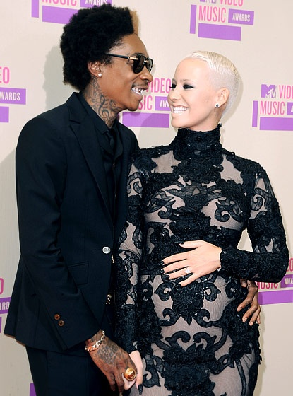 "Wiz Khalifa and Amber Rose. After more than a year of dating, the ""Black and Yellow"" rapper proposed to his model girlfriend in March 2012."