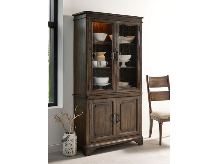 What better way to display your heirloom glassware and china then with a gorgeous, Vintage style display cabinet? The seeded glass doors on the china cabinet deck are the perfect compliment to a rustic, industrial, or traditional room. The inside of the cabinet provides versatile storage and display for all your favorite pieces with adjustable shelving, plate grooves, and touch display lighting.
