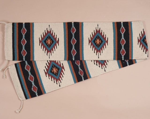 Hand woven wool southwest table runner featuring an outstanding southwest or western design. This southwestern table runner is great for cabin, lodge or log home comfort or for that special rustic cow