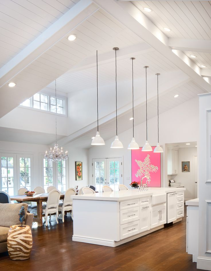 Vaulted ceilings, white wood finishes, and an abundance of natural light in this Colorado ranch remodel prove a one-story home can still feel expansive.
