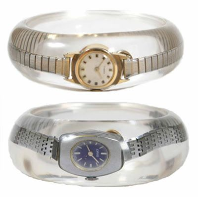 vintage watches encased in resin bracelets. My grandmother wears watches like these. Would be nice to have one day.