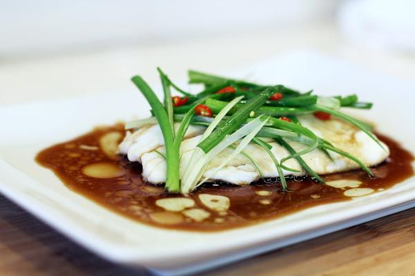 Chinese Steamed Fish Recipe-◾2 Stalks of Green Onions ◾2 inch Piece of Ginger Root ◾¼ Teaspoon Thai Chilies ◾2 Tablespoon Low Sodium Soy Sauce ◾1/8   Teaspoon Sesame Oil ◾1 Tablespoon Canola Oil ◾4 Ounce Halibut Fillet