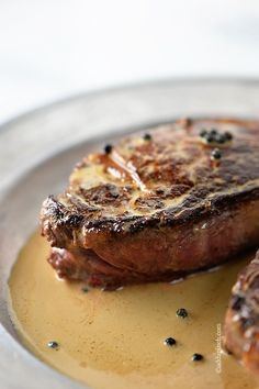 Peppercorn Sauce Recipe - Cooking -Wow! The flavor this sauce gives a steak is Amazing! // addapinch.com
