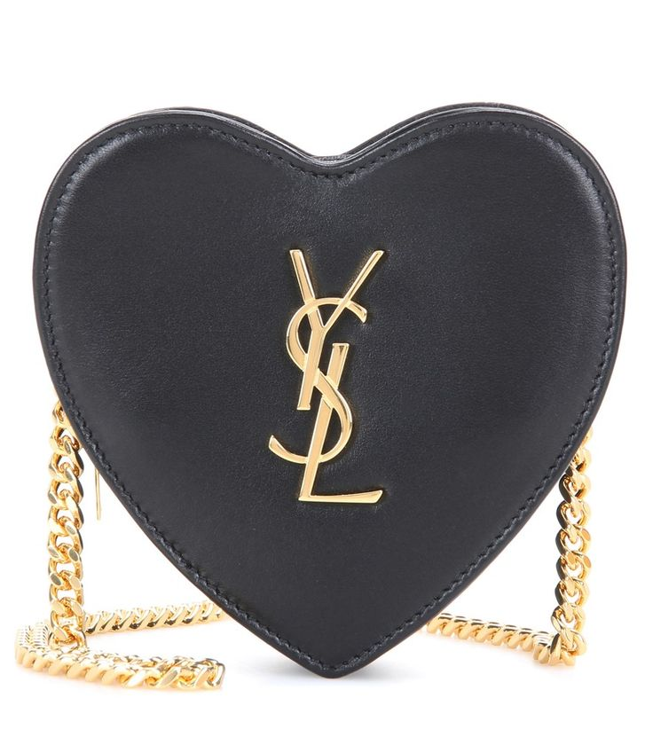 Saint Laurent - Mini Love Heart leather crossbody bag - Saint Laurent's Mini Love Heart crossbody bag might be petite, but it's delightfully full of impact. Crafted from smooth black leather and structured in a heart shape, this YSL-initialled style is perfect for an evening out, keeping all your important cards and lipstick safe. seen @ www.mytheresa.com