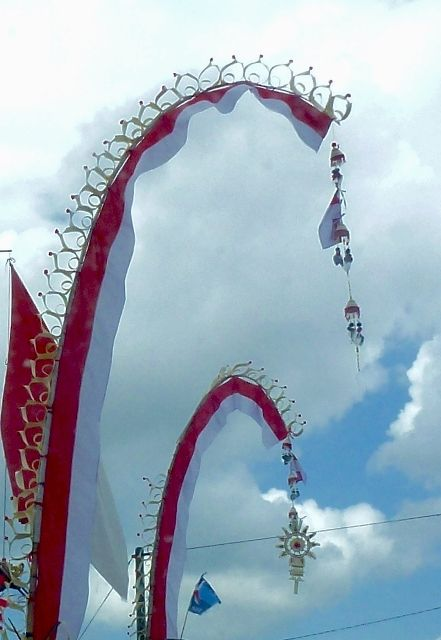 Red and white penjor decorate Bali streets in celebration of Merdeka , Indonesia's Independance Day