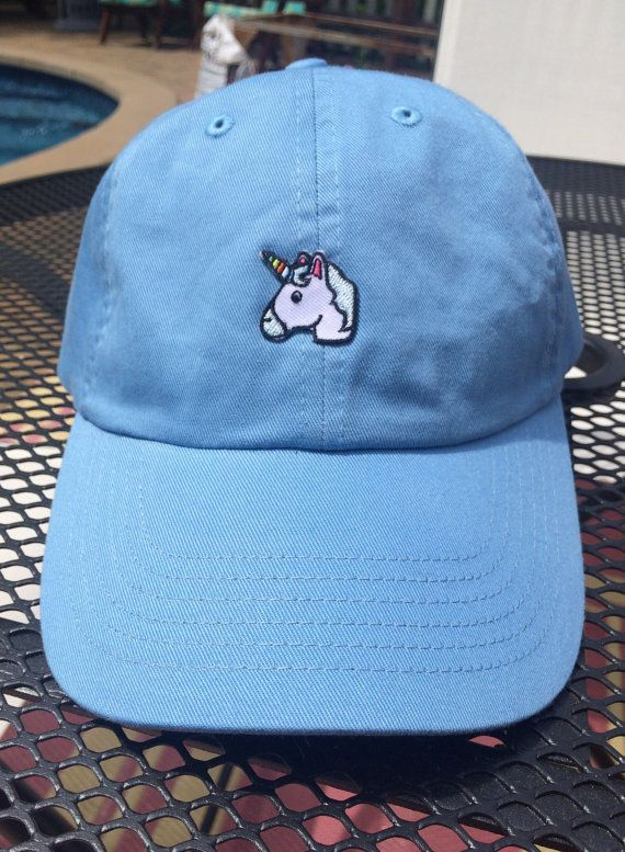Unicorn patch on blue baseball hat by HiddenPatches on Etsy