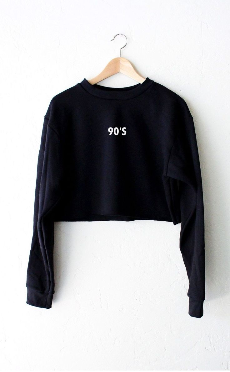 """- Description Details: Oversized, loose fit cropped sweater in black with print featuring '90s' on front center. Brand: NYCT Clothing. Measurements (Size Guide): XS/S: 40"""" bust, 17.5"""" length, 25"""" slee"""