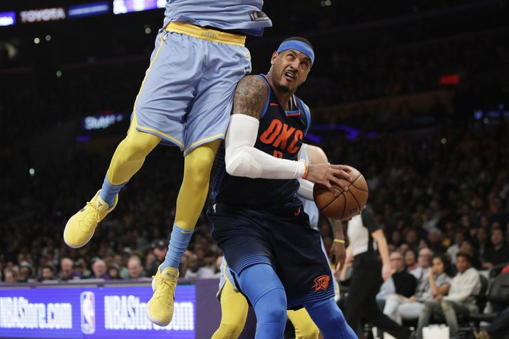 Oklahoma City Thunder's Carmelo Anthony, right, is defended by Los Angeles Lakers' Julius Randle during the first half of an NBA basketball game, Wednesday, Jan. 3, 2018, in Los Angeles. (AP Photo/Jae C. Hong)