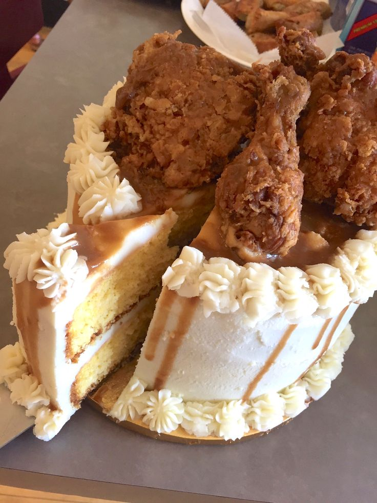 This cake is made from cornbread with mashed potato icing, drizzled with brown gravy and topped with fried chicken.