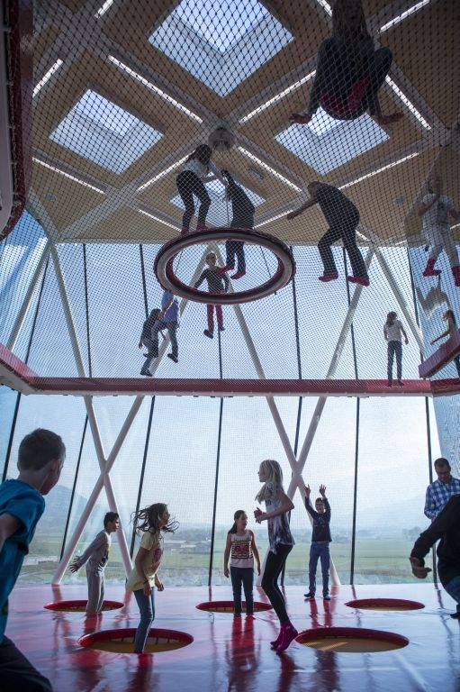 The playtower of Swarovski Crystal Worlds gives children all kinds of playing experiences from climbing, rocking, and swinging to sliding and even to what looks like floating. The form of playing this offers is completely new but perfectly natural. A vertical climbing net is spread over several levels arranged on top of each other; it can be climbed up to a height of just under 14 meters.