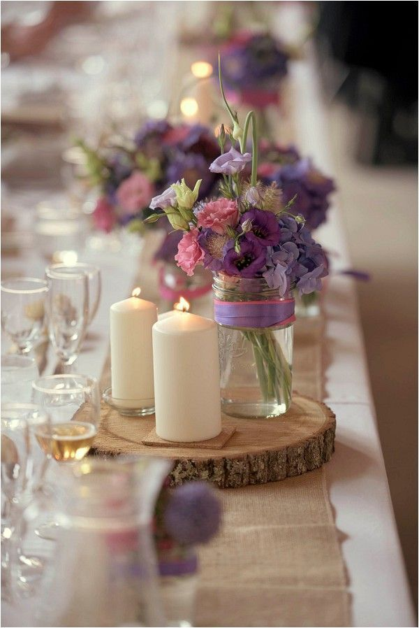purple tone and rustic wedding decorations | Image by Awardweddings