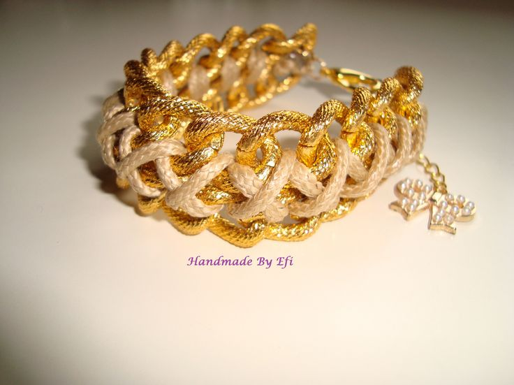 bracelet with chain and leather cord in beige  https://www.facebook.com/pages/Handmade-Creations-by-Efi/187659788043676