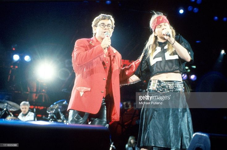 Elton John and Axl Rose of Guns N' Roses perform on stage at the Freddie Mercury Tribute Concert, Wembley Stadium, London, 20th April 1992.