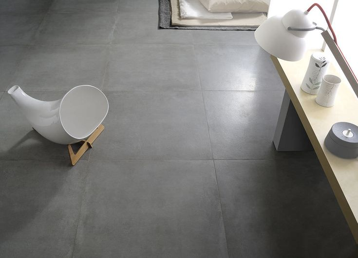Concrete look floor tiles - might be cheaper than honed or polished concrete