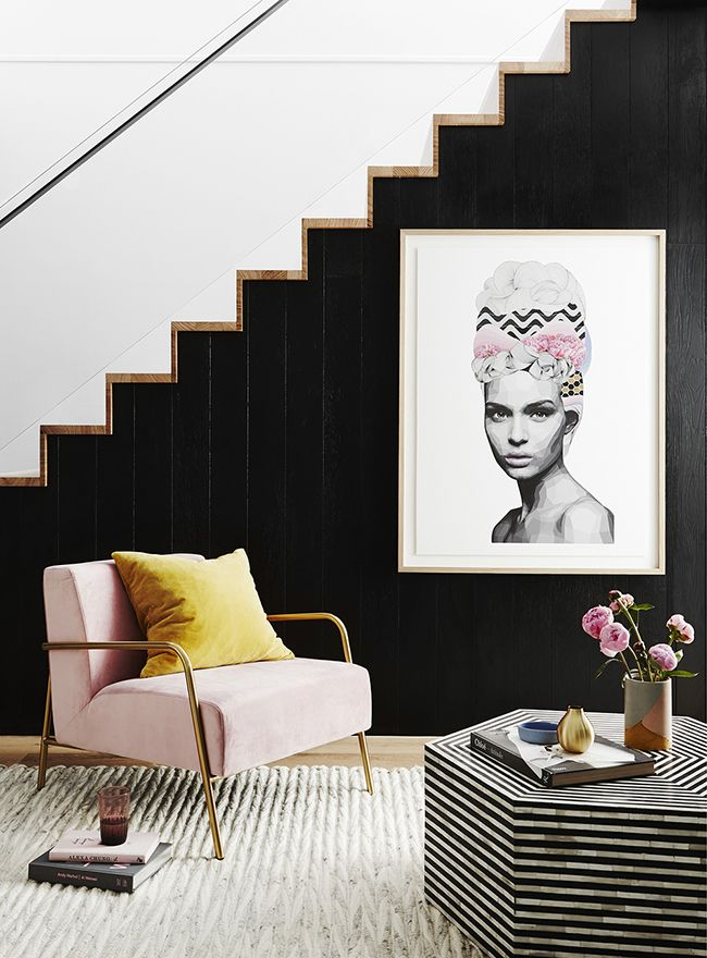 blush pink and mustard living area with gold accents