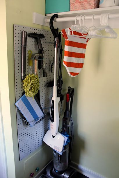 Finished Laundry Room: Storage Corner    Pegboard for extra Dyson attachments, etc.