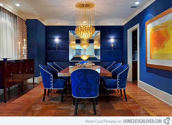 Carolyn Miller Interiors    Guess you have seen this dining area pretty much but it deserves such feature because this is one catching royal blue dining room with an orange wall art decor.