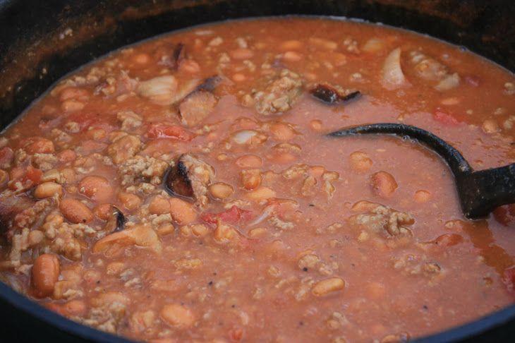 John Wayne Beans Recipe Main Dishes with hamburger, garlic, onions, pork, pinto beans, rotel tomatoes, tomato sauce, smoked sausage, salt, pepper