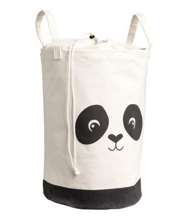 White/panda. Cylindrical storage basket in thick cotton twill with a printed motif. Two handles at top and plastic coating inside. Diameter 13 1/4 in.,