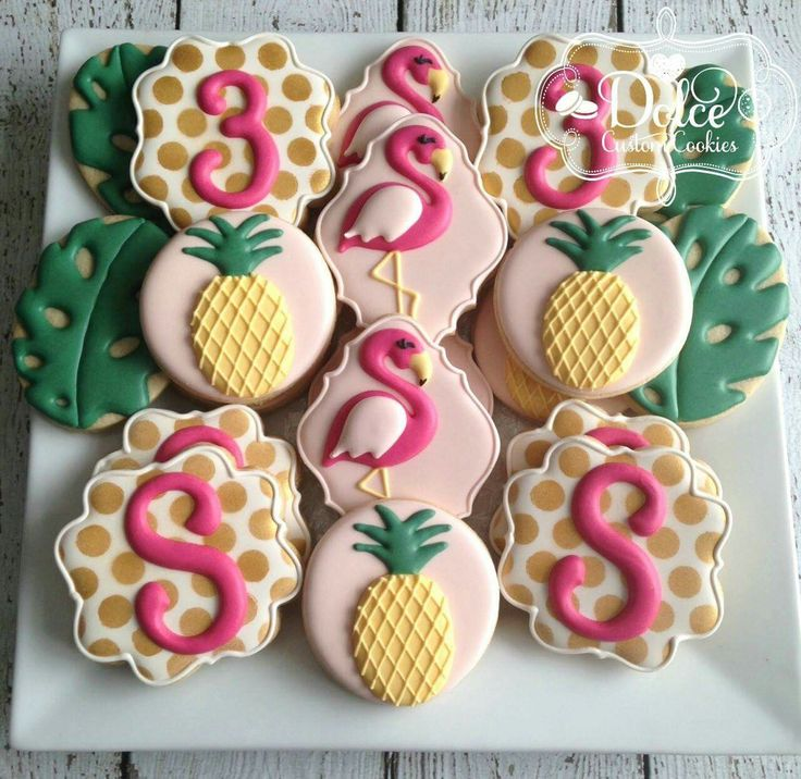 Dolce. Flamingoes, pineapples, and tropical leaves.