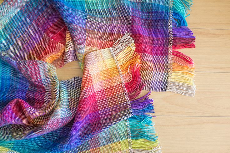 Tutorial for weaving this colourful scarf on a rigid heddle loom.