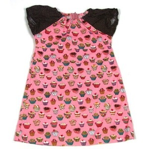This dress is made with a vibrant waterfall of pink cupcake fabric and accented with chocolate brown & white polka dot sprinkled sleeves. $36