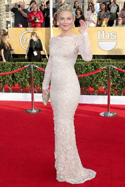 'American Hustle' star Elisabeth Rohm officially opened the red carpet in a very feminine, yet form-fitting, champagne colored Marchesa gown.