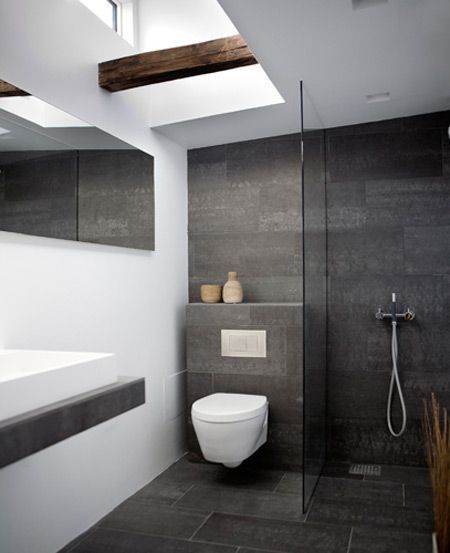Modern bathroom with rustic wood beam and lots of natural light. Clean, efficient.