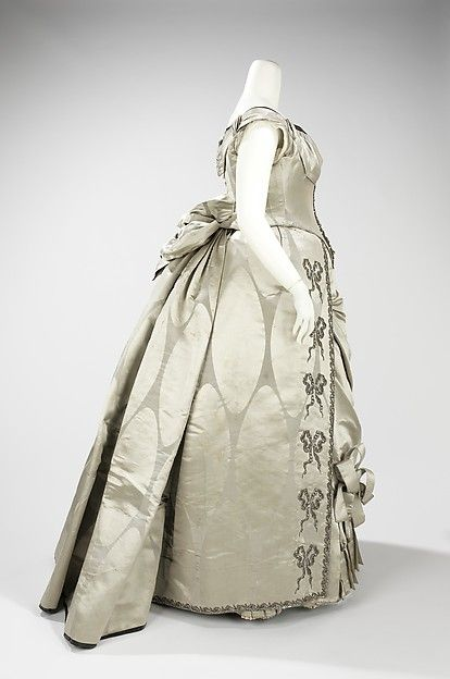 Evening dress Design House: House of Worth (French, 1858–1956) Designer: Charles Frederick Worth (French (born England), Bourne 1825–1895 Paris) Date: 1888 Culture: French Medium: silk, metal