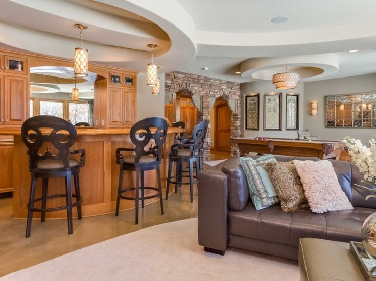Architecture:Marvelous Basement Finishing Ideas With Sofas Cushions On Cream Rugs Feat Kitchen Bar And Bar Stools With Pendant Lighting Also Kitchen Cabinets With Marble Floor Plus Billiards With Pendant Lights The Coolest Basement Finishing Ideas for Your On – going Remodeling Basement