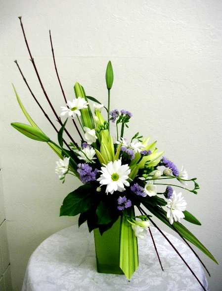 contemporary floral arrangements they say flower arrangement it automatically means european floral - Silk Arrangements For Home Decor 2