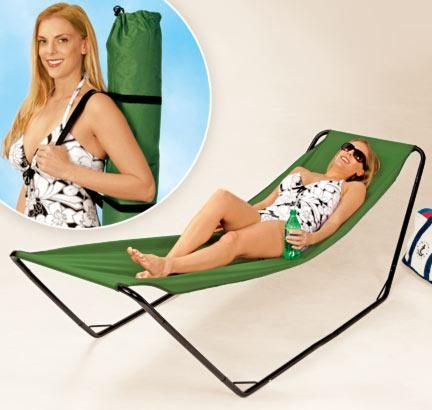 """This time around she's """"modeling"""" a hammock-like beach chair that is easily portable in a bag-like contraption. Description from imbringingbloggingback.com. I searched for this on bing.com/images"""