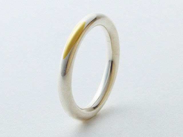 This silver wedding ring eventually wears away revealing the gold below the surface over time.