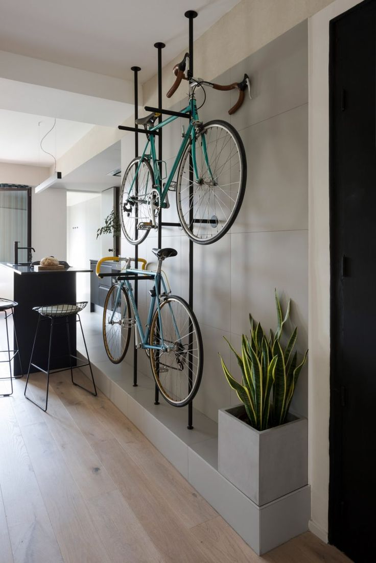 Colombo and Serboli Architecture has revamped a Barcelona apartment, opening up the partitions to create a large living space with a bespoke, wall-mounted bicycle rack.