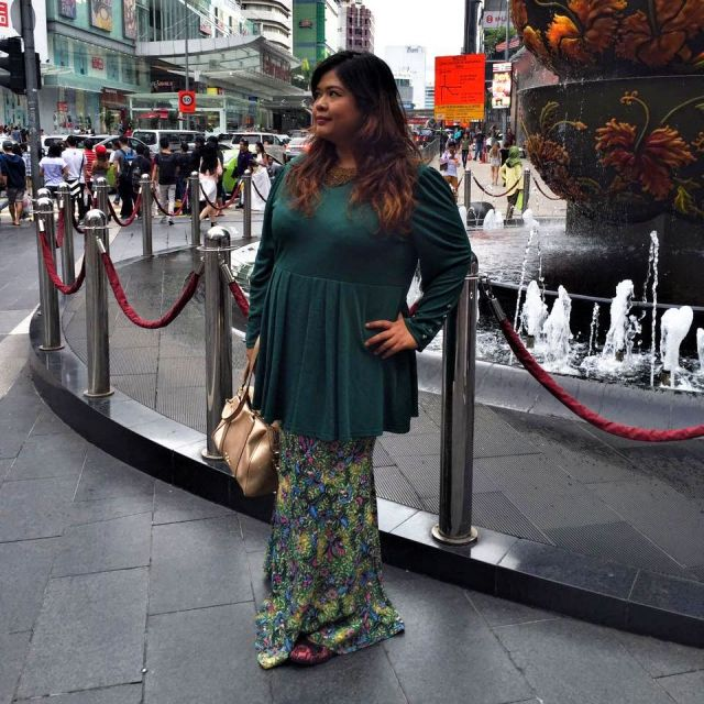 @nadiakamira is donning our latest one piece kurung dress. Looking stunning in the busy city. We totally in love with it..