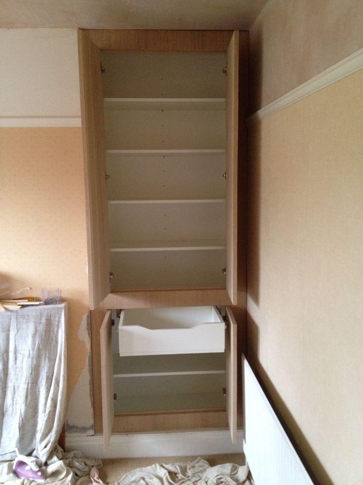 We installed a bespoke oak finished storage unit with adjustable shelves, one draw soft close hinges