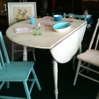Antiqued off white table with two antiqued turquoise chairs and two antiqued pink chairs. Fitzsfurniture@gmail.com on Facebook. $150.00