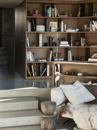 A relaxed bookcase gives the living room a homely, inviting feel.