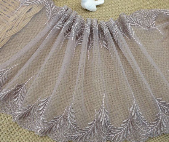 Light brown mesh lace trim with luna leave pattern embroidered on both edges