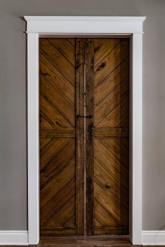 This Includes Two 24 X 84 Wide Matched Barn Doors In Walnut Stain Black Iron J Style Barn Door Hardware An Barn Door Barn Doors Sliding Interior Barn Doors
