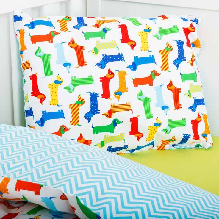 Sausage dogs in action. Colourful, happy and friendly sausage dogs will comfort your little one to sleep Soft 100% cotton duvet cover with co-ordinated blue zig zag materials Matching blue zig zag pillow case and Sausage dogs resting on the front side.