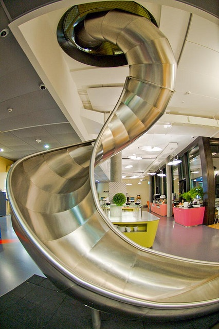 Google Zurich office has a slide.  That would be instant decompression.  You could offer it to your clients that are mad.  Customer service would go through the roof.  Maybe every corporation should invest @ Raeann Voorhies, what you you think?