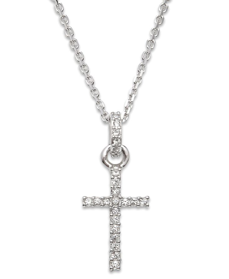 Give the gift of faith dusted with sparkling Swarovski crystal. This traditional cross pendant features round-cut crystal accents on the cross and bail. Crafted in silver-tone mixed metal. Approximate
