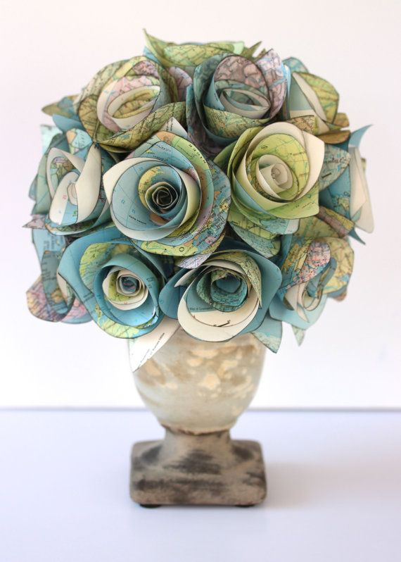 handcrafted boquet of rolled roses ... upcycyled map papers ... available on Etsy ...